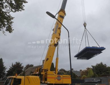 Autolift met hijskraan